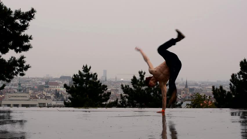 Breakdancer dancing breakdance in the rain in Prague   Shutterstock HD Video #6361925