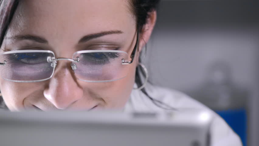 Close up of lab technician using tablet computer | Shutterstock HD Video #6373217