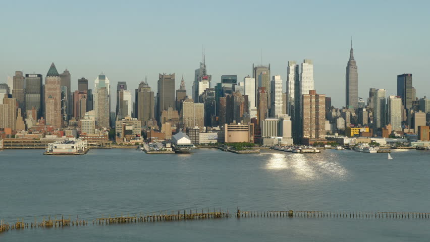 Sunlight reflects off the windows of the mid-town Manhattan skyline and the Hudson River during late afternoon. | Shutterstock HD Video #6375050