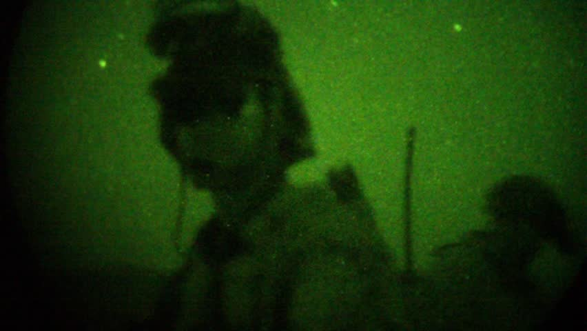 Night Vision: special ops soldiers on night mission wearing night vision goggles