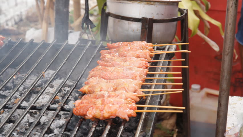 Grilled chicken skewers on a hot stove./Grilled chicken | Shutterstock HD Video #6386267
