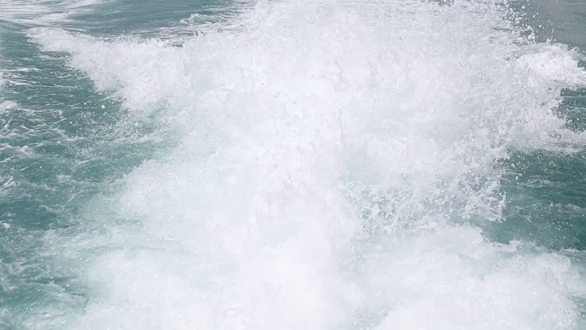 Blue ocean sea water wave with fast yacht boat wake foam of prop wash   Shutterstock HD Video #6386648