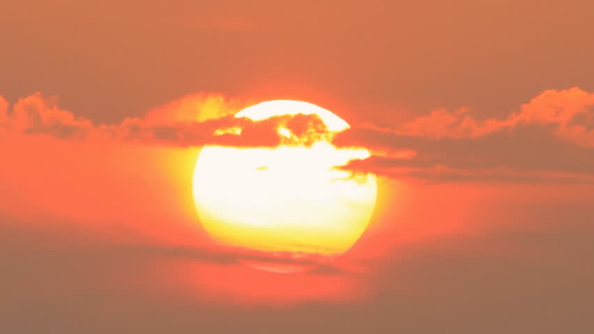 Huge sun going down at the sunset clouds passing by | Shutterstock HD Video #6395573