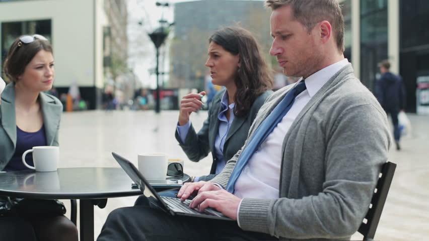 Businesspeople sitting in street cafe, steadycam shot  | Shutterstock HD Video #6396548