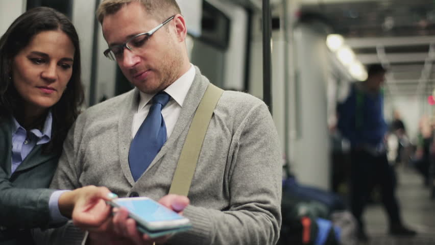 Couple chatting in the subway, steadycam shot  | Shutterstock HD Video #6398309
