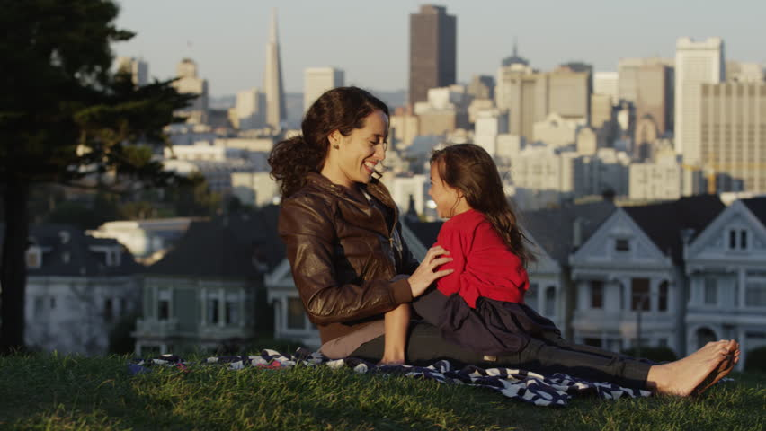 USA, California, San Francisco, Alamo Square Park, Woman with daughter (4-5) playing in park