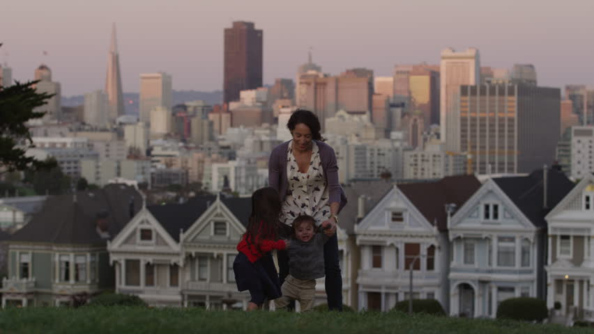 USA, California, San Francisco, Alamo Square Park, Woman with daughter (4-5) and son (2-3) playing in park