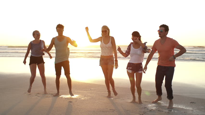 Friends dancing and jumping on beach #6423065