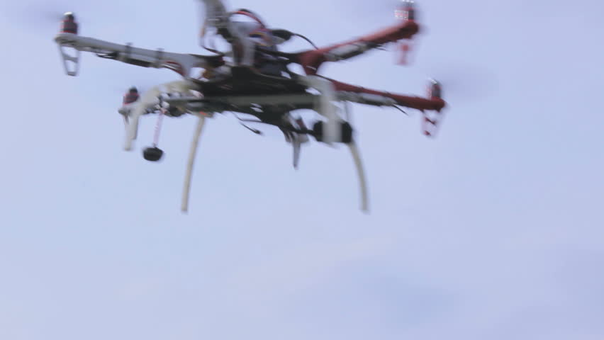 Drone flying in the sky, view from the bottom up
