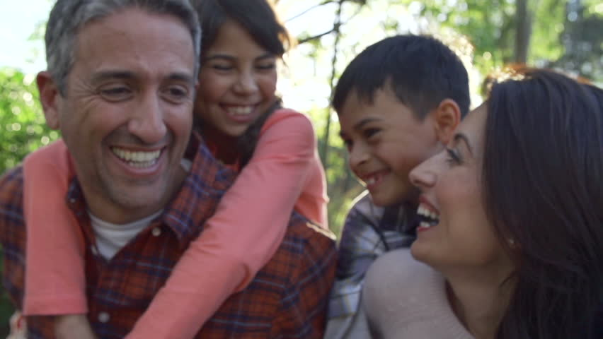 Slow Motion Sequence Of Parents Giving Children Piggyback