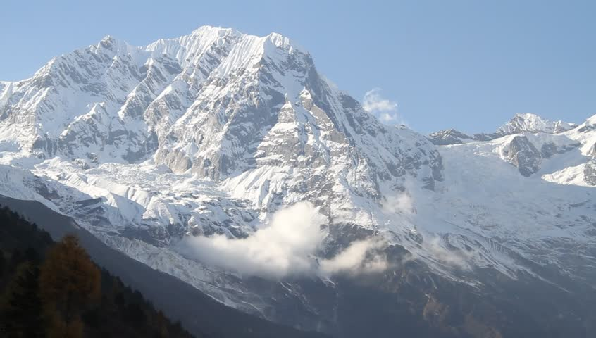 Blue sky and peak of Manaslu in Nepal | Shutterstock HD Video #6470684