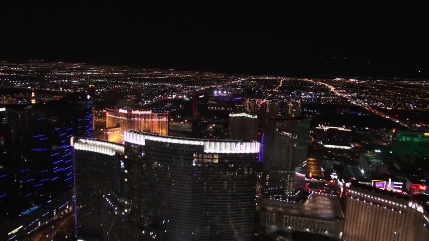 Vegas Strip Aerial Night Flying high above the Vegas Strip at nighttime - see the spectacular resorts that illuminate the skyline. In this shot, see the Aria, MGM, and Monte Carlo.