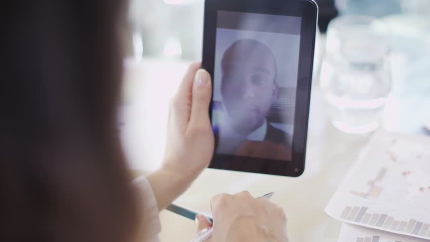 Office workers have meeting on tablet