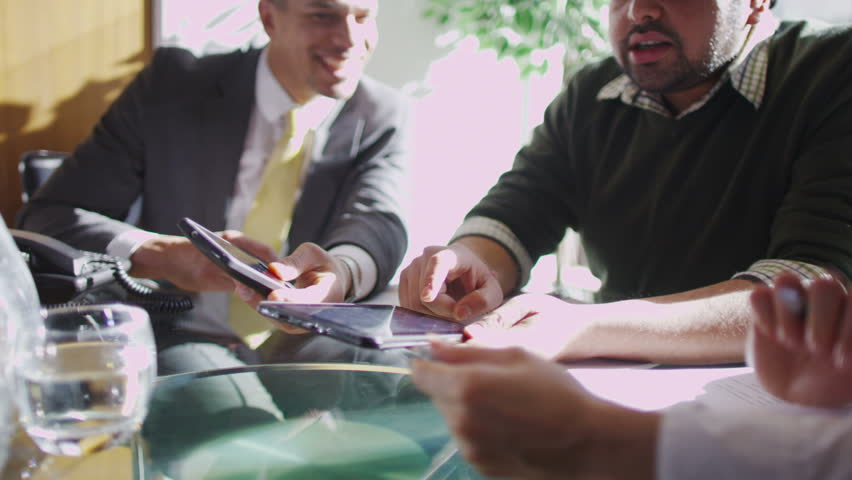 Office workers discuss plans | Shutterstock HD Video #6496622