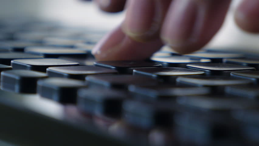Keyboard typing (macro) Hands touch typing on a black wireless keyboard, camera performs a circular overflew. Close up