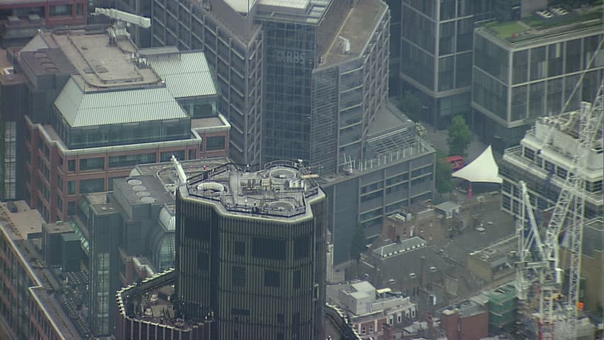 LONDON, UK - MARCH 28: Aerial view of Central London with a zoom out of Tower 42, revealing the Gherkin and other buildings in The Canary Wharf Financial District on March 28, 2010 in London, UK | Shutterstock HD Video #6502433