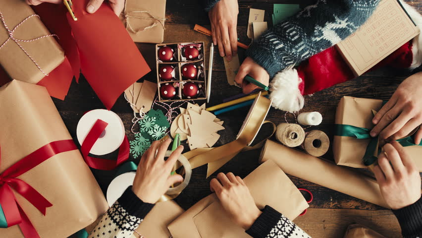Hands wrapping Christmas presents arial view group of young diverse people | Shutterstock HD Video #6521174