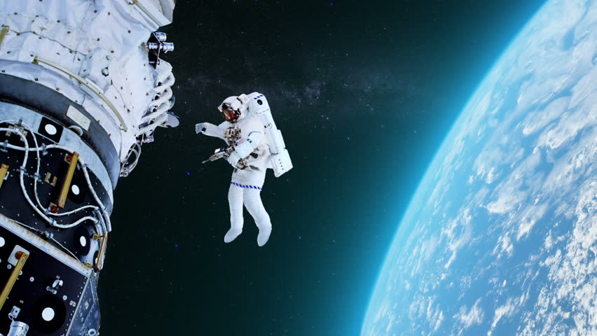 Astronaut working on a spaceship. Elements of image furnished by NASA.  MORE OPTIONS IN MY PORTFOLIO.