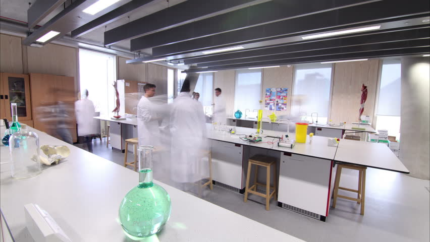 Time lapse group of students working in science class in modern university.