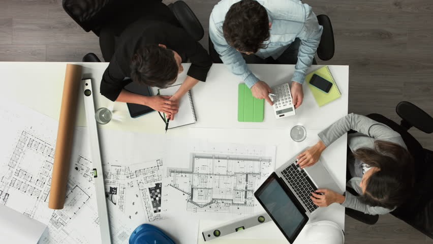 Architect plans arial view business meeting showing teamwork young diverse startup | Shutterstock HD Video #6554471