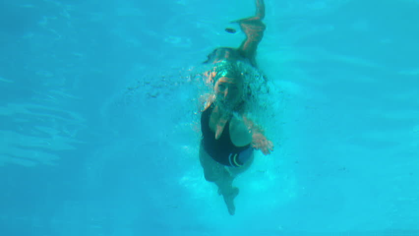 Fit woman swimming in the outdoor pool in slow motion #6556487