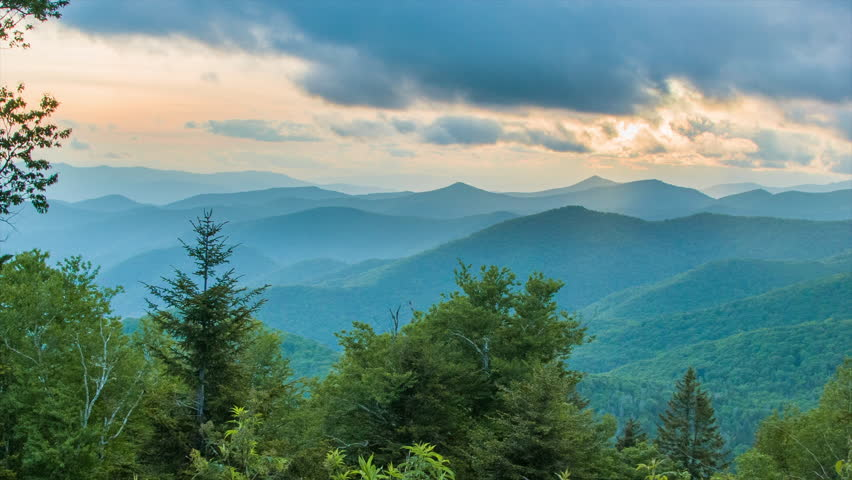 Caney Fork Overlook on the Blue Ridge Parkway at Sunset over the Smoky Mountains near Asheville, North Carolina with layers of the Appalachian Mountains and a Golden Colored Sky.