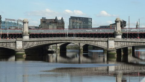 Trains and traffic cross the River Clyde, King George V bridge, Glasgow, Scotland
