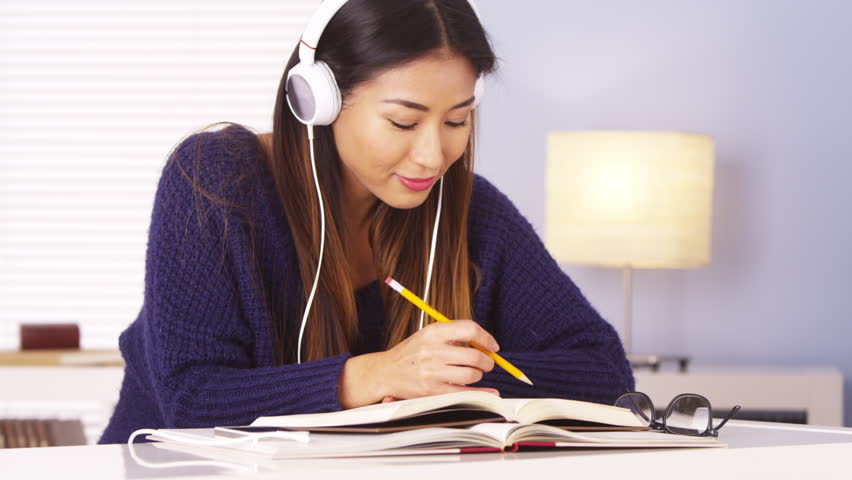Japanese Woman Listening to Music Stock Footage Video (100% Royalty-free) 6599342 | Shutterstock
