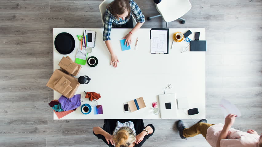Mixed race group of people aerial view timelapse hipster office small business start up company planning creative meeting | Shutterstock HD Video #6604382