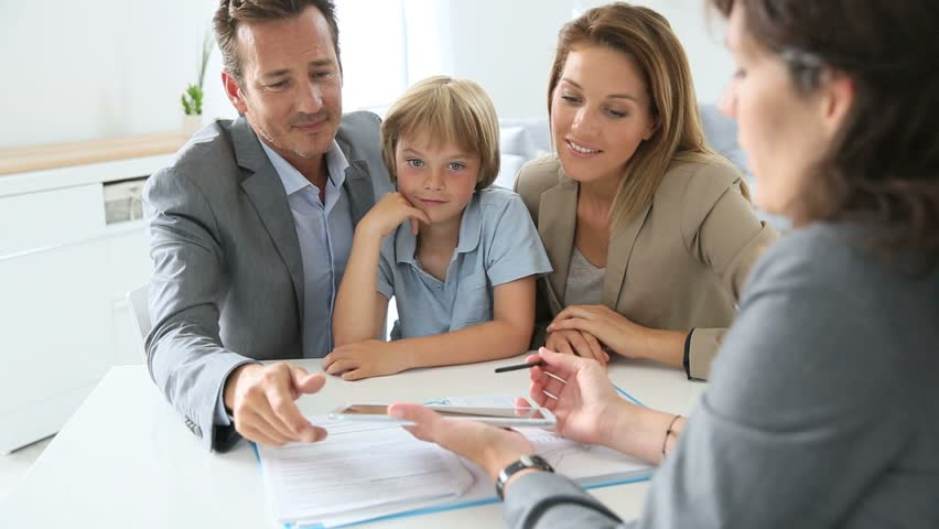Family signing home purchase contract on tablet Royalty-Free Stock Footage #6623156