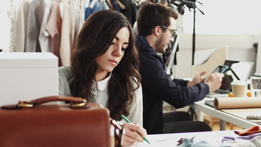 Fashion designers in small business startup company creating sustainable textiles