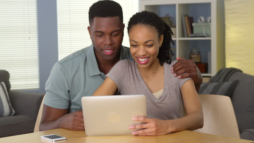 Smiling young black couple waving and having video chat with family over tablet | Shutterstock HD Video #6645614