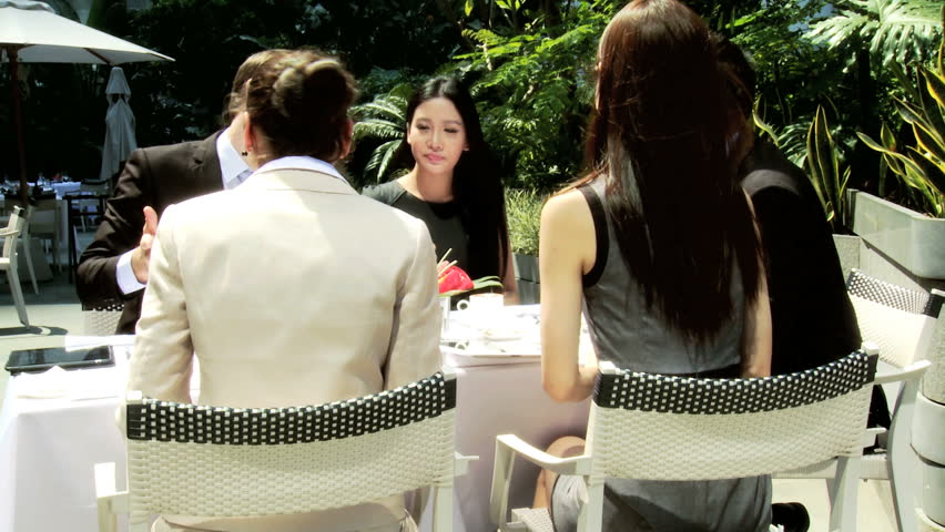 Asian Chinese Caucasian male female banking associates meeting touch screen tablets drinking coffee downtown rooftop restaurant | Shutterstock HD Video #6646898