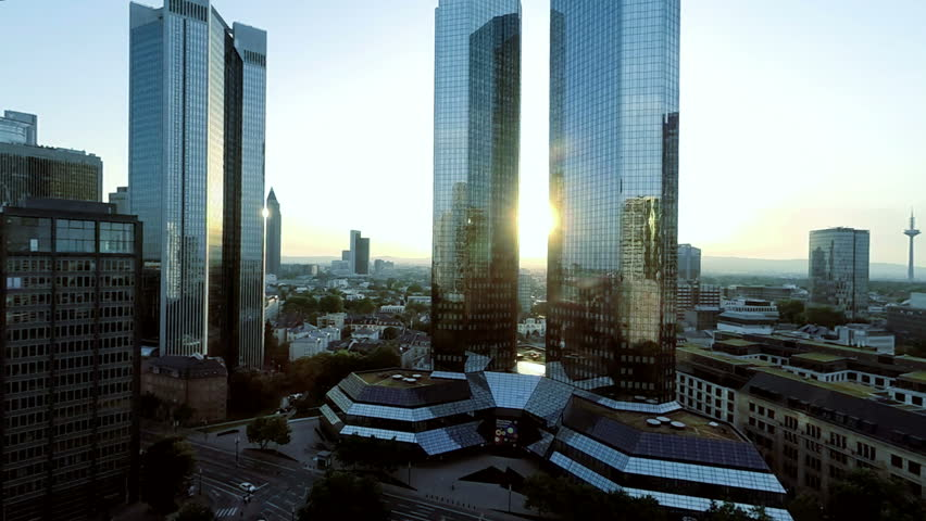 Aerial view of city skyline at sunset. frankfurt business banking district. skyscrapers towers buildings. fly over. helicopter view