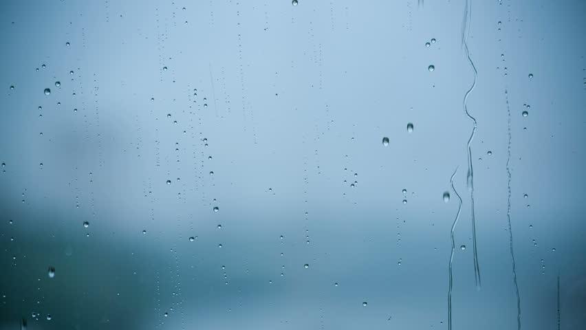 Beautiful Rain Drops running down a Window pane. HD 1080.