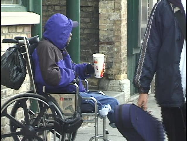 Homeless Man in Wheelchair | Shutterstock HD Video #67075