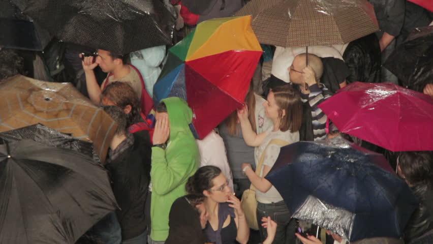 "ROME - MAY 1 2013: Crowd under the rain at ""Concerto del Primo Maggio"" (""Workers' Day Concert""), Piazza San Giovanni (San giovanni Square) - Workers' Day, Rome, Italy. | Shutterstock HD Video #6710236"