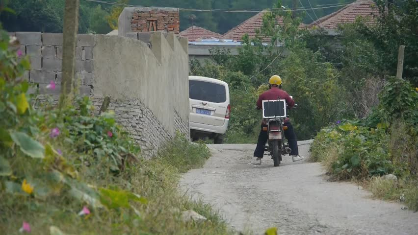CHINA - OCT 12, 2013,Motorcycle traveling on country road.  #6728545