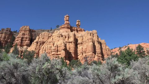 BRYCE CANYON, UTAH - JUN 2014: Bryce Canyon red rock twin pillar towers. Red, orange, and white colors of the rocks provide spectacular views for park visitors. Designated a Park in 1928.