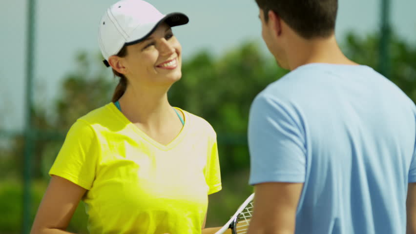 Young Caucasian male female wearing bright sports clothes preparing game tennis outdoors close up shot on RED EPIC   Shutterstock HD Video #6757606