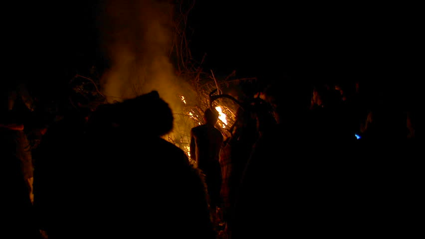 MASSERANO, ITALY - MAY 3: Celts walk around bonfire during Beltane festival on May 3, 2014 in Masserano, Italy | Shutterstock HD Video #6758011