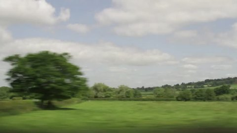 Passing view of green scenery in Dartmouth, UK.  Footage taken from moving vehicle.