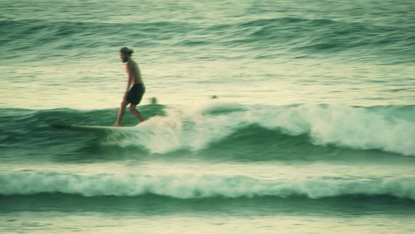 Australia 2012. Surfer riding a small wave on a longboard, carving, walking on the board etc   Shutterstock HD Video #6776236