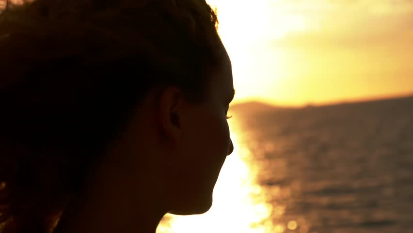 Inspired Happy Woman Enjoying Freedom and Serenity at Sunset during Beautiful Sea Voyage. Slow Motion. Close up. | Shutterstock HD Video #6778213