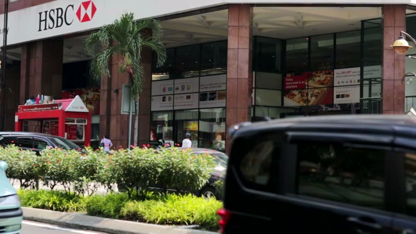 KUALA LUMPUR, MALAYSIA - CIRCA JUNE 2014: HSBC Bank branch. HSBC Holdings plc is a British multinational banking and financial services company. It is one of the world's largest banks. | Shutterstock HD Video #6778396