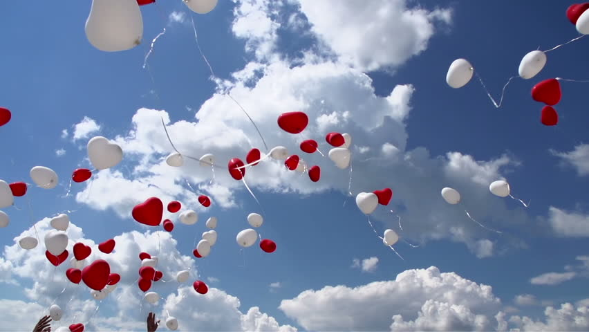 Balloons in the Sky. Balloons in the form of red and white hearts soar in the sky. Slow Motion at a rate of 240 fps #6780646