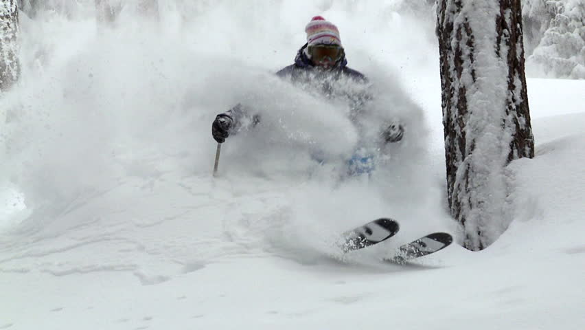 Slow motion skier carving through thick fresh powder snow, multiple shots,   Shutterstock HD Video #6783370