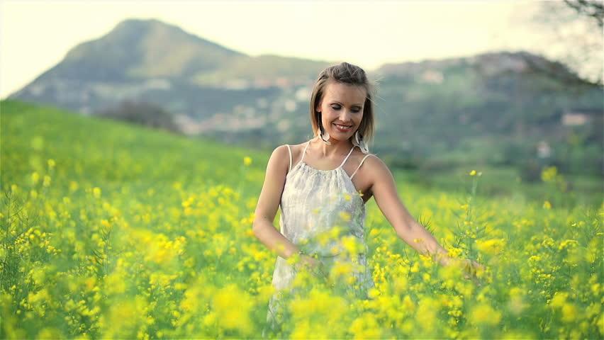 Beautiful young woman in rape field