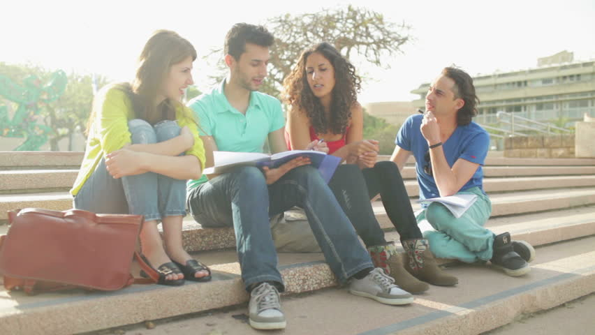 Static close up of four students doing home task outdoors Royalty-Free Stock Footage #6791116