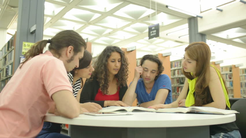 Young people studying in the library and posing for a photo Royalty-Free Stock Footage #6791146